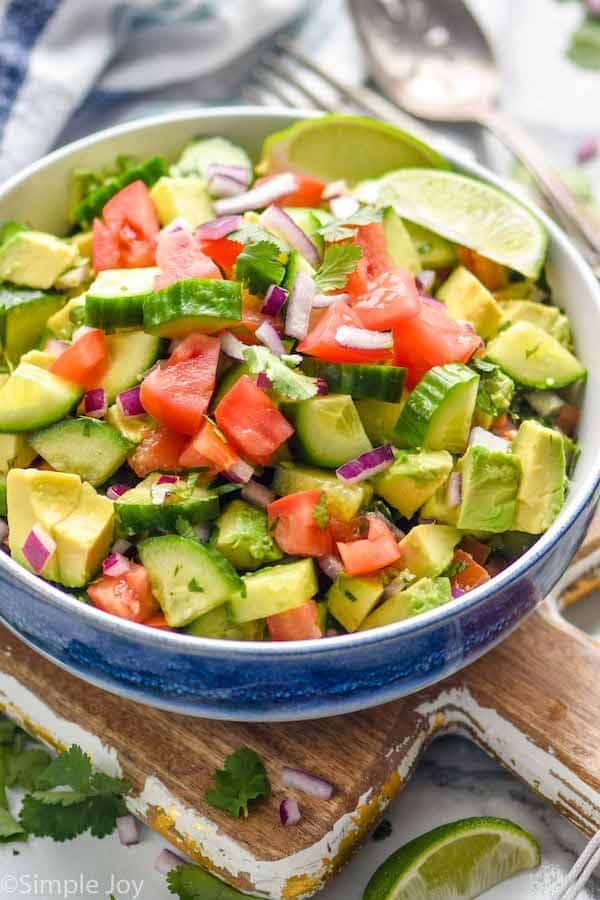 bowl full of cucumber tomato avocado salad