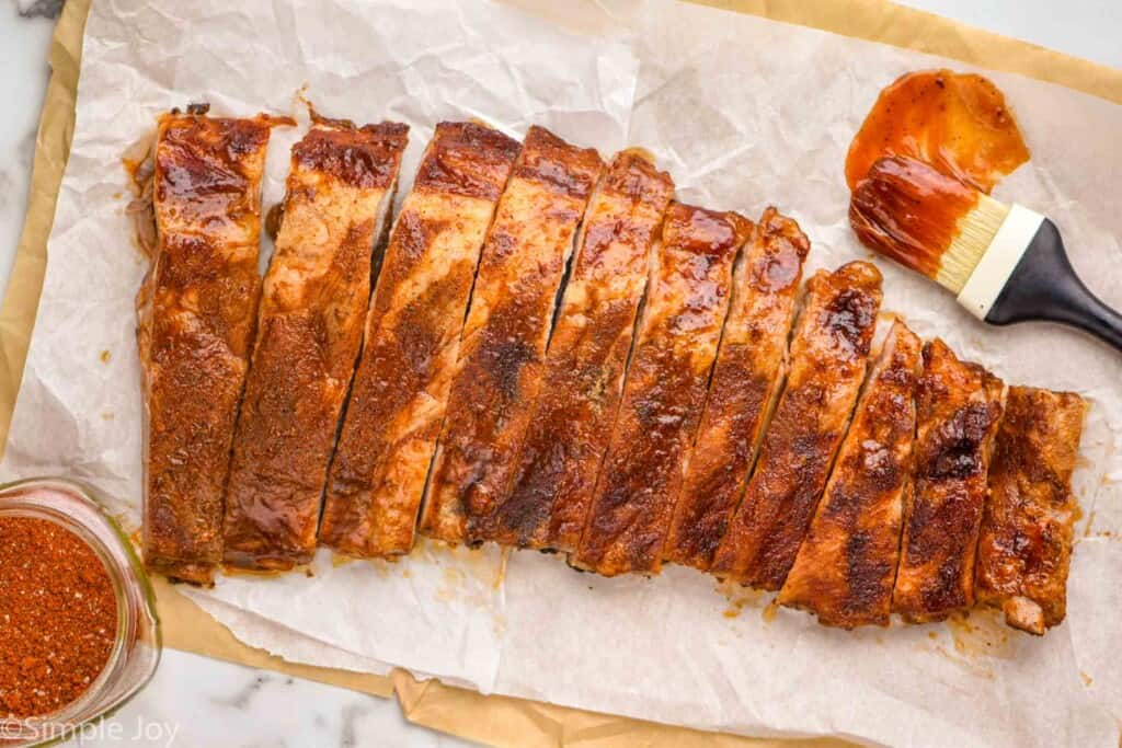 a rack of ribs that has been cooked and cut