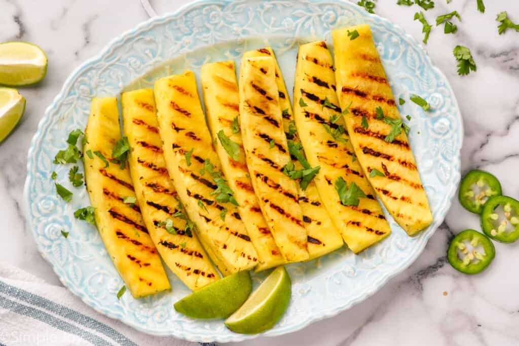 a platter with wedges of grilled pineapple