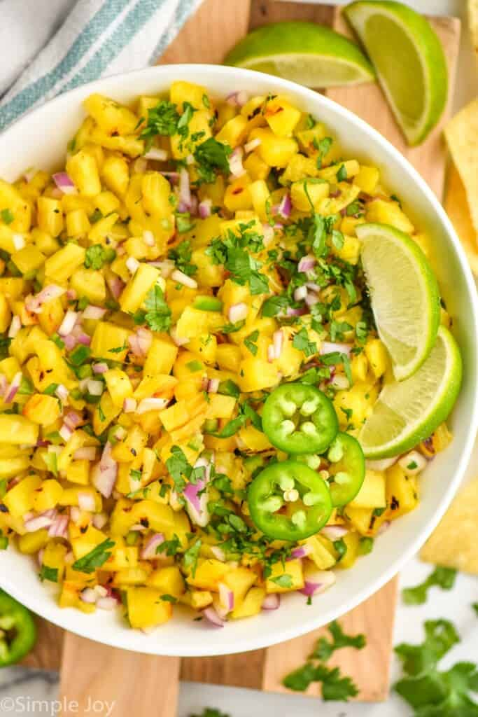 overhead of a bowl of grilled pineapple salsa