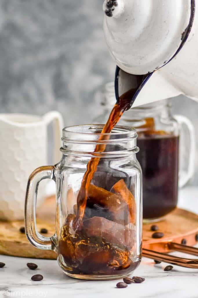 coffee being poured over coffee ice cubes