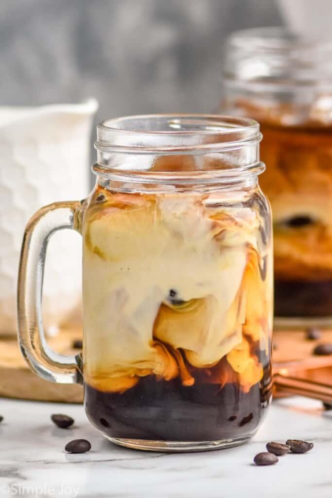 close up of a mason jar mug of iced coffee