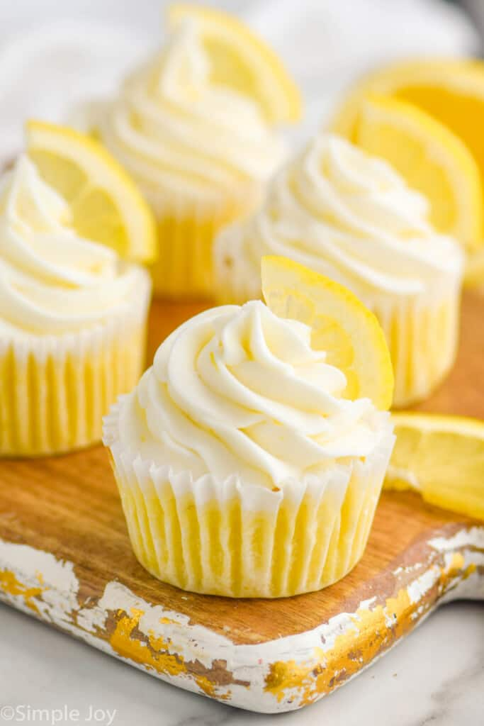 close up of lemon cupcakes on a tray