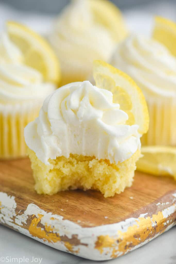 close up of a lemon cupcake that has been bit into