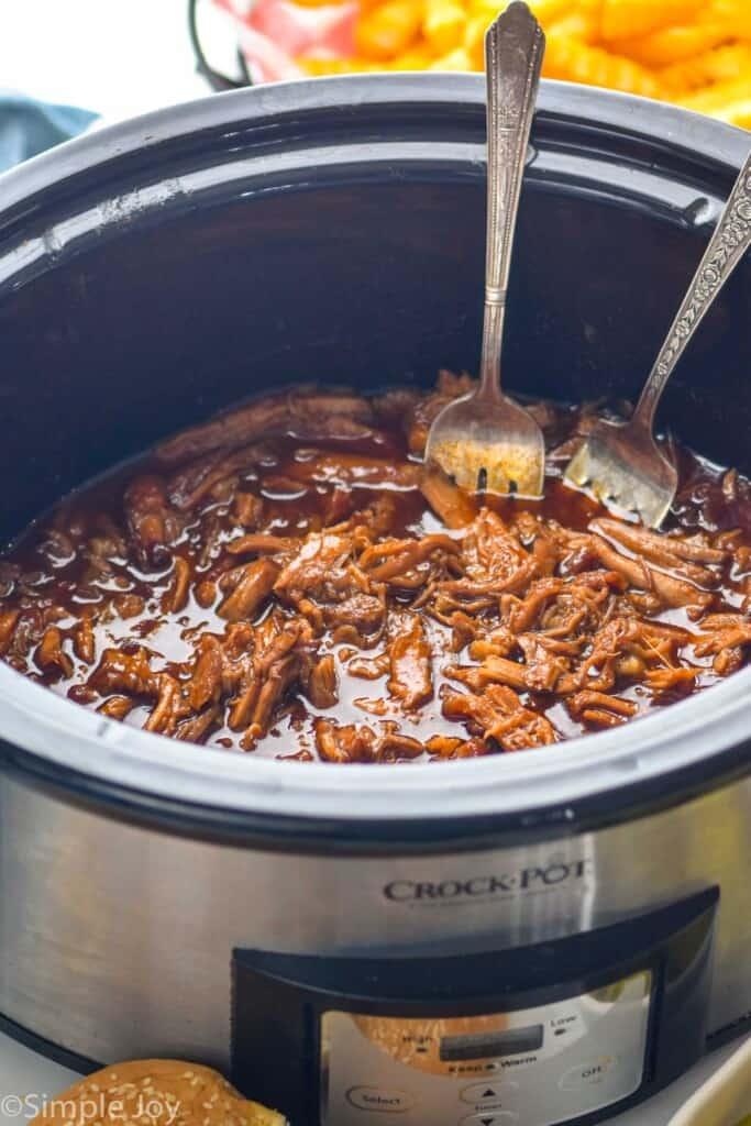 slow cooker pulled pork in a crock pot