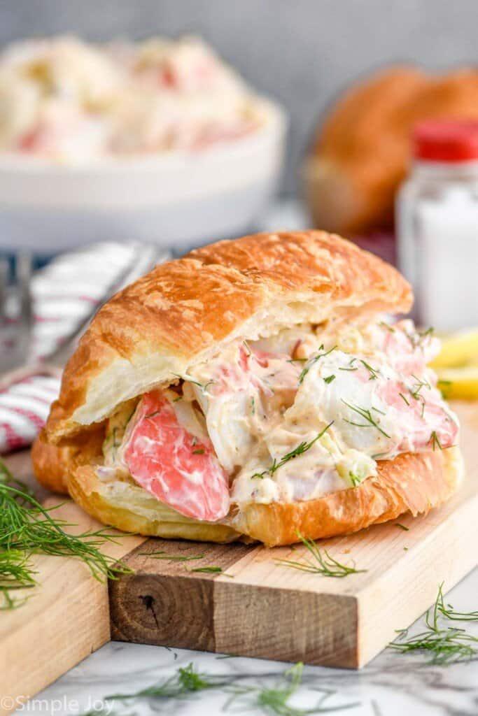 crab salad sandwich on a cutting board