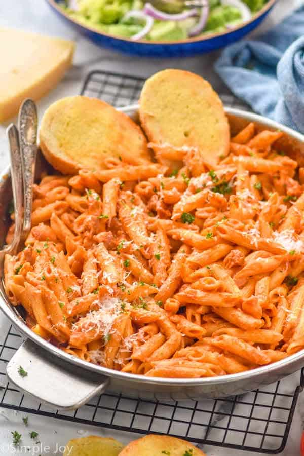 side view of a skillet full of penne Alla vodka
