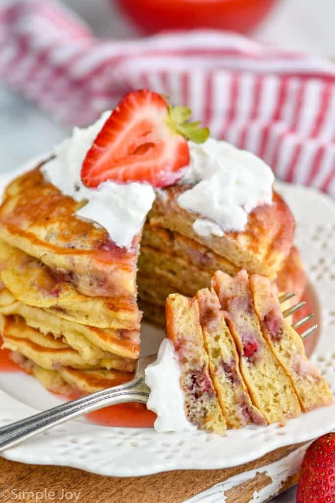 strawberry pancake recipe with a bite cut out and on a fork