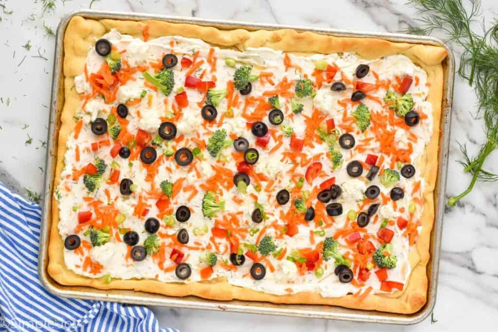 overhead image of cold veggie pizza