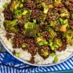 pinterest graphic of overhead of ground beef and broccoli recipe in a bowl over rice