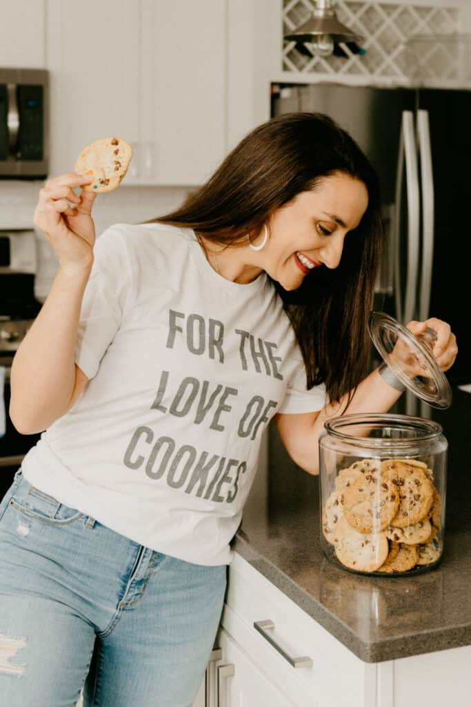 """woman in a white t-shirt that says """"for the love of cookies"""""""