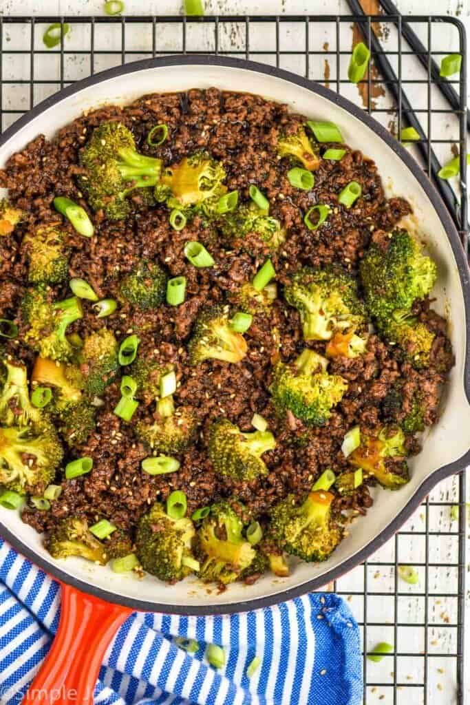 overhead of a beef and broccoli stir fry in a frying pan