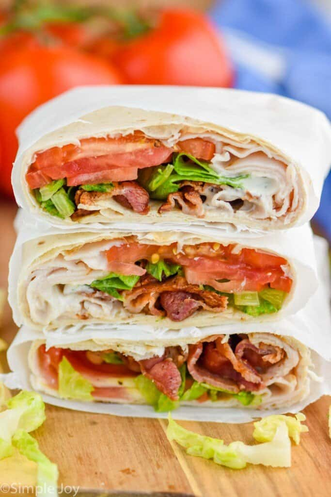 a stack of blt wraps cut in half