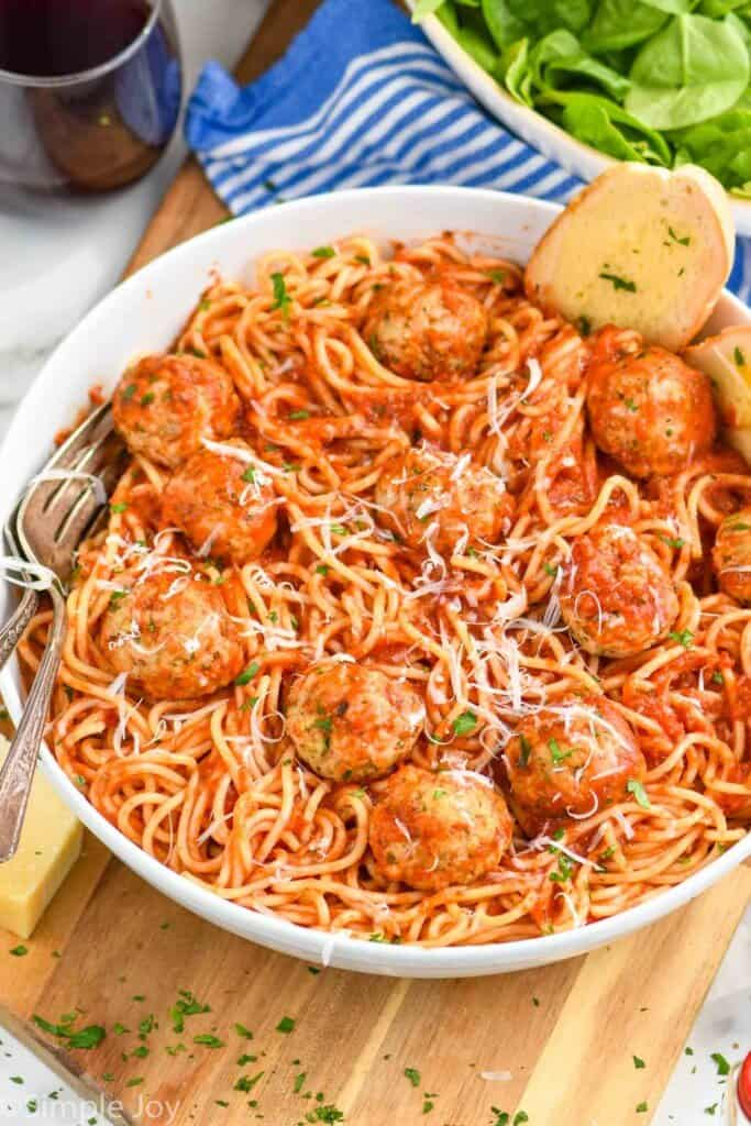bowl of spaghetti with chicken meatball recipe all covered in sauce