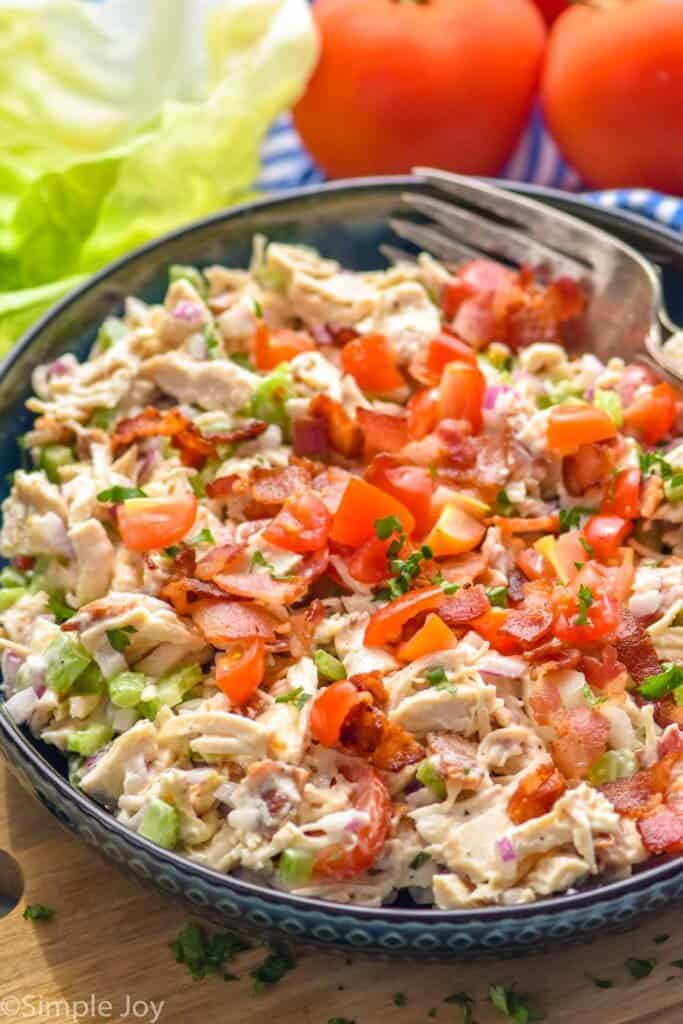 a bowl of chicken salad with bacon