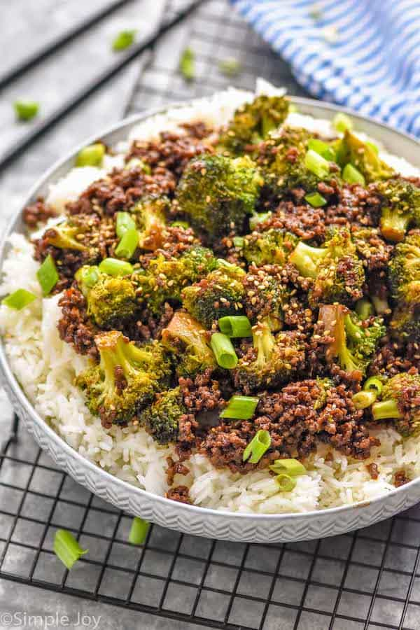 side view of a bowl of ground beef and broccoli over rice