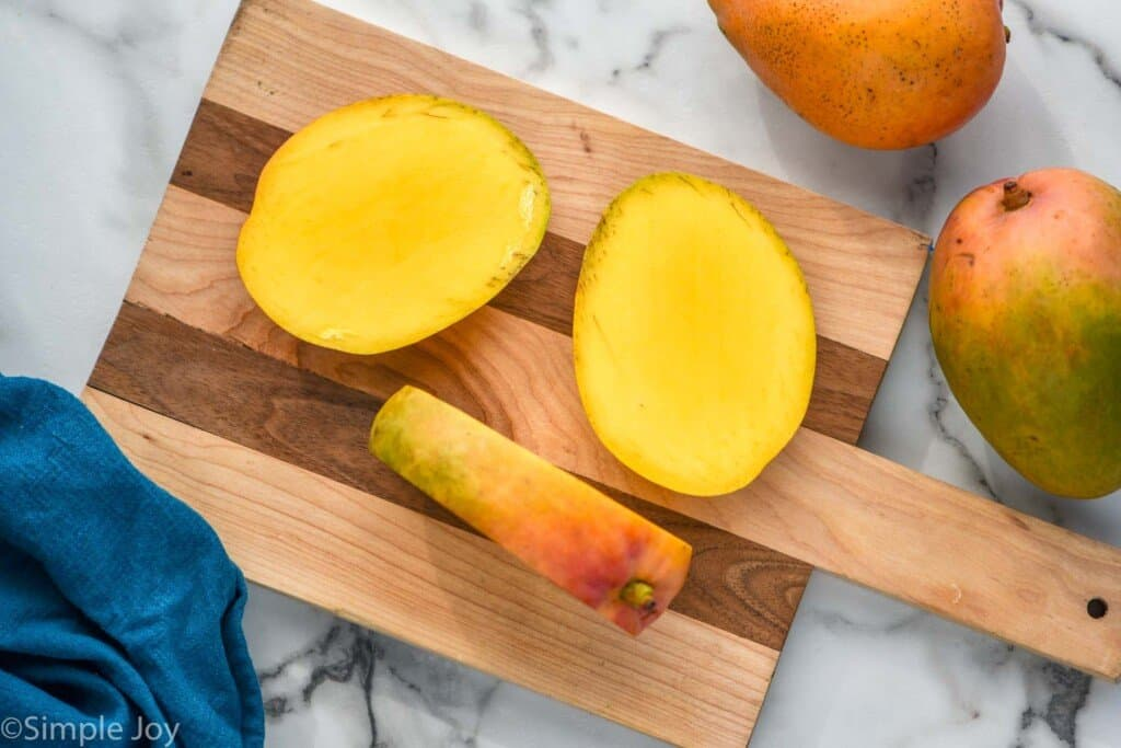 a mango with both sides of the pit cut off