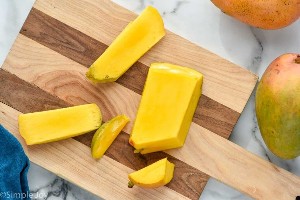 a mango being cut up