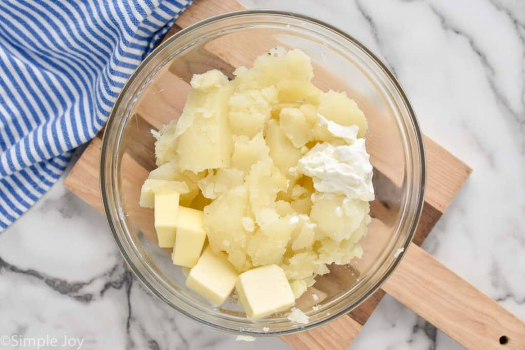 potato filling, sour cream, and butter in a bowl to make easy twice baked potatoes