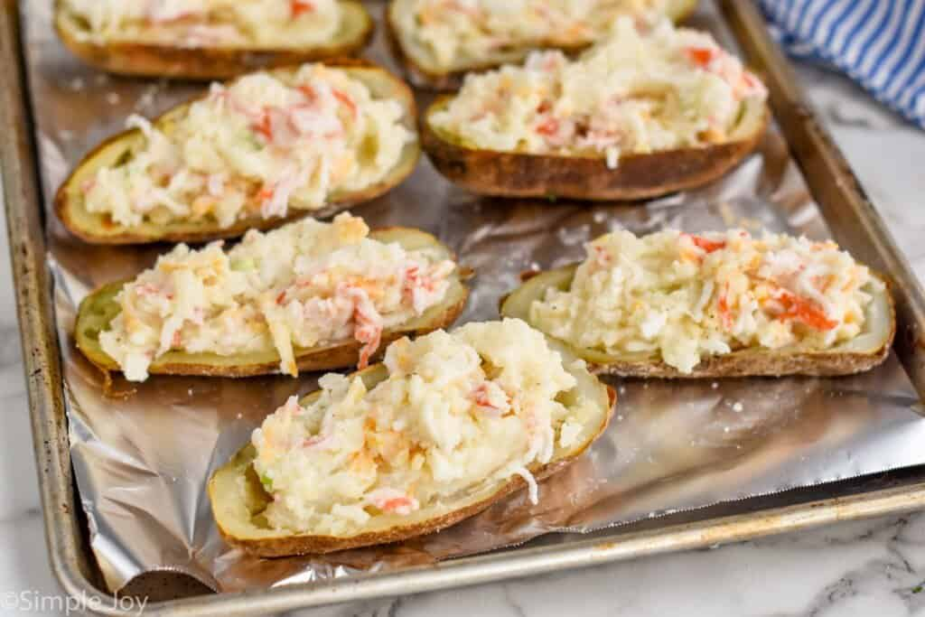 twice baked potatoes stuffed and ready to go back in the oven