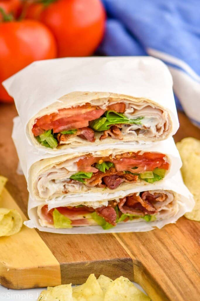 a pile of three blt wraps that have been cut in half