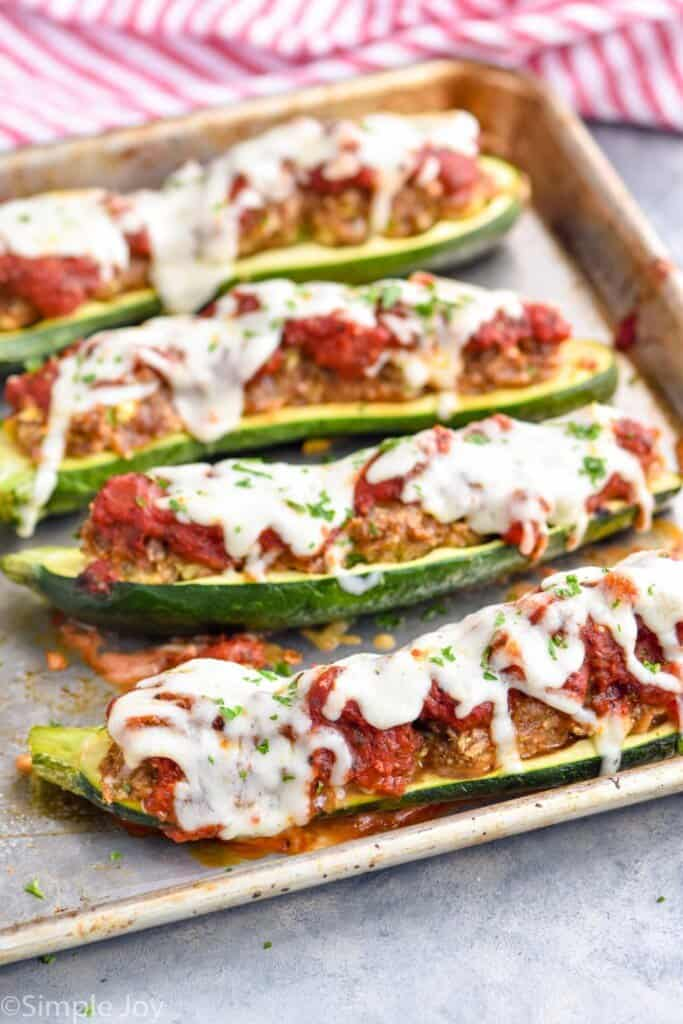 zucchini boats recipes on a rimmed baking sheet
