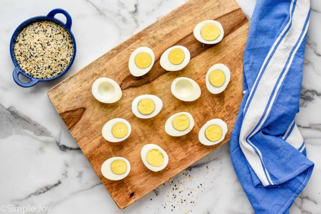 overhead of hard boiled eggs cut in half to make deviled eggs
