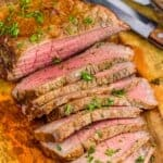 a London broil cut up on a cutting board