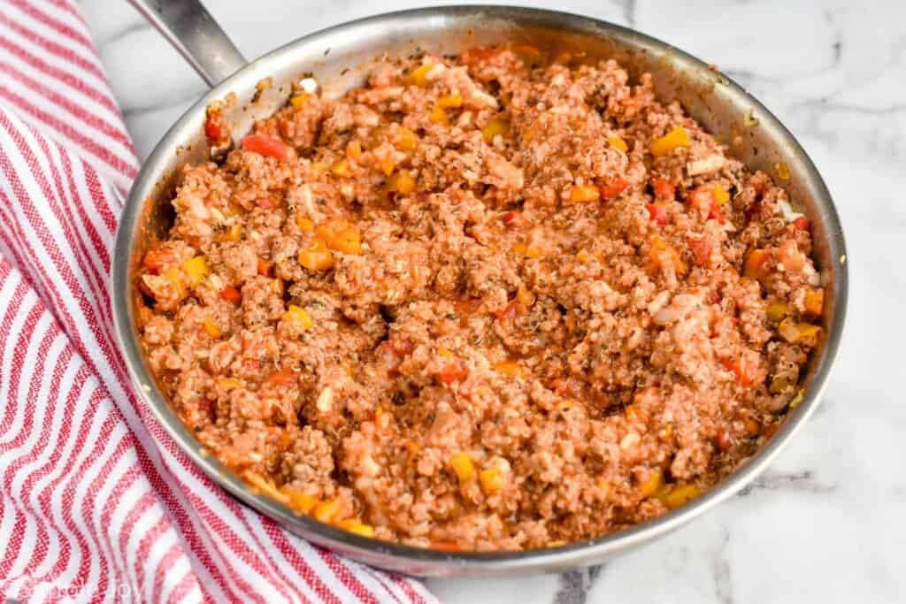 a skillet filled with stuffing for turkey quinoa stuffed peppers