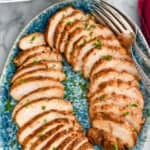 pinterest graphic of turkey tenderloin sliced and on a platter