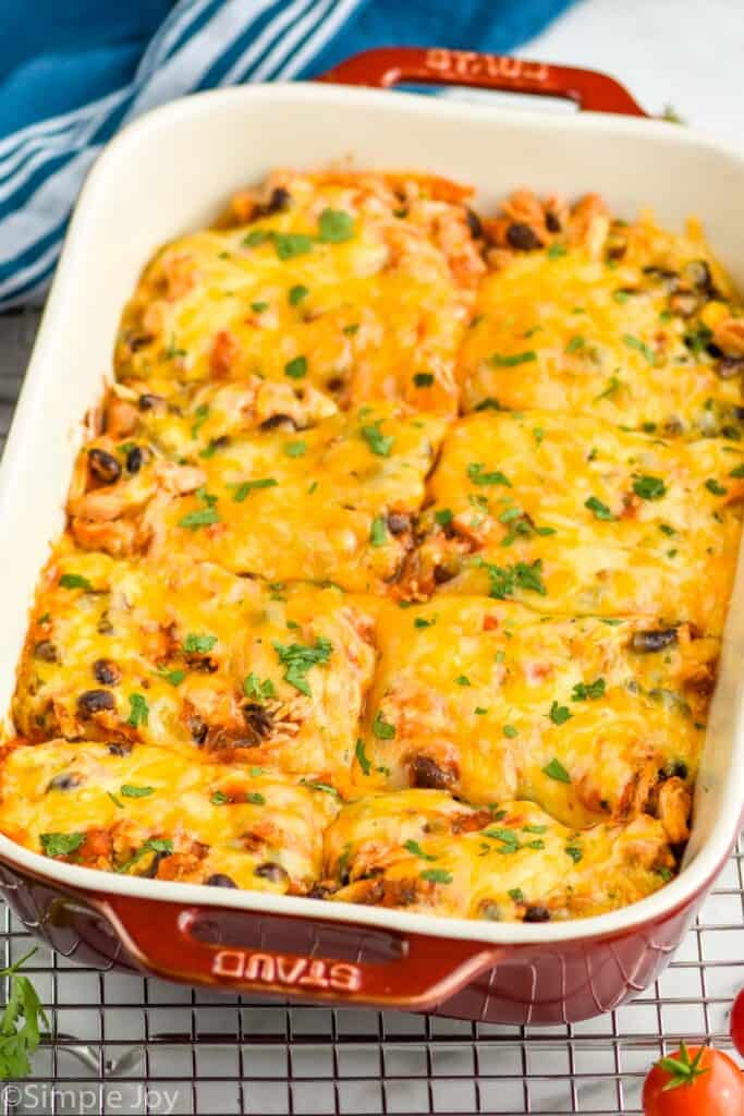 side view of a baking dish with easy chicken enchilada casserole