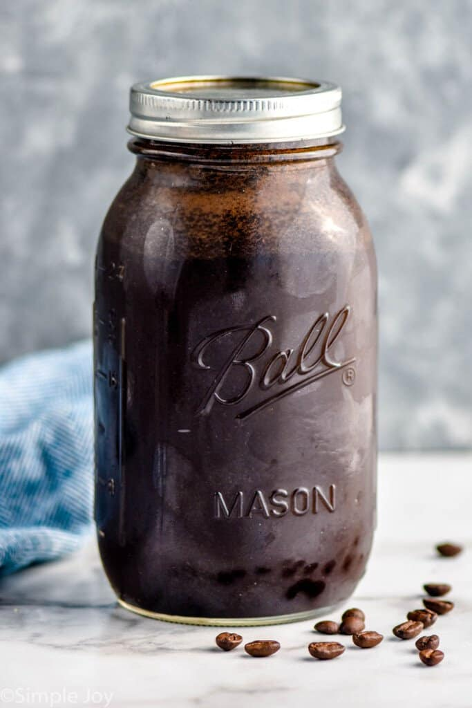 a mason jar full of water and ground coffee