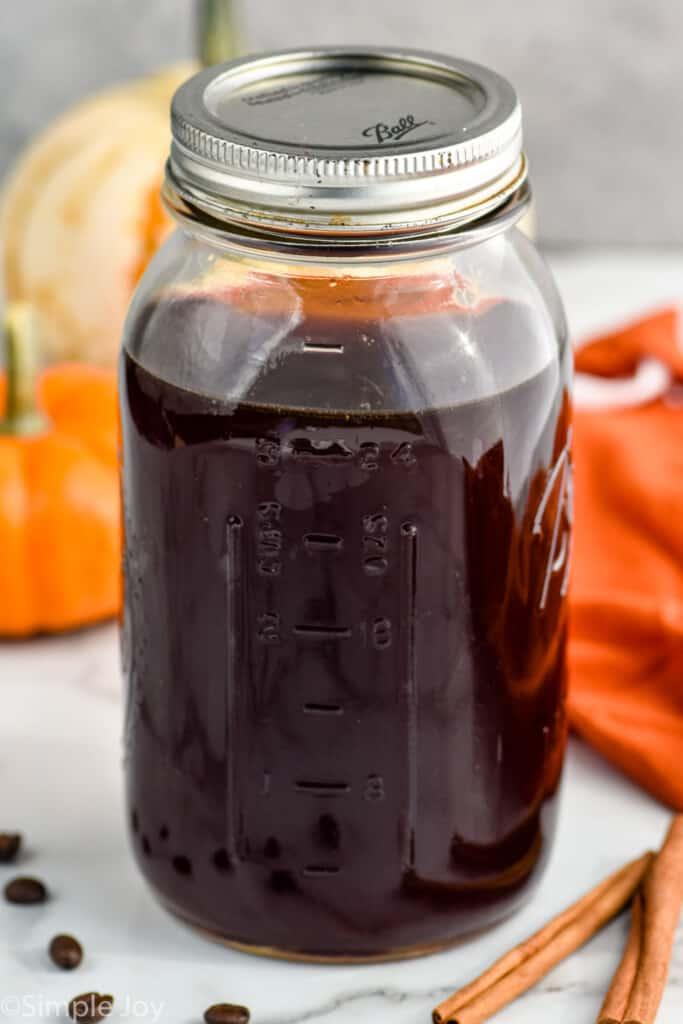 a mason jar of pumpkin spice cold brew