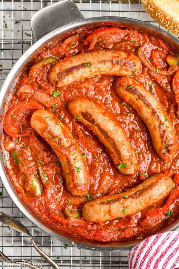 overhead of a skillet of sausage and peppers